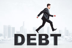 Man overcome debt problems concept at city background Stock Image