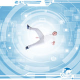 Man in modern technology environment. With icons for jet travel, communications and internet Royalty Free Stock Images