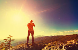 Man overlooking the mountains belown Royalty Free Stock Image