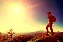 Man overlooking the mountains belown Stock Photo