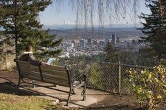 Man overlookng Portland, Oregon stock photography