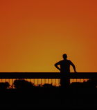Man on the overpass. Man standing on the overpass and thinking about his problems and the meaning of life royalty free stock image