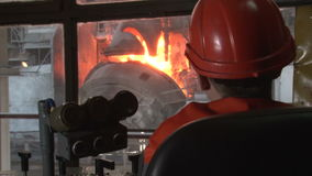 Man oversees the work of the basic oxygen furnace stock footage