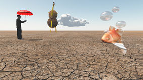 Man and oversized cello with floating fish. In desert Royalty Free Stock Images