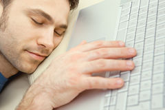 Man overslept by laptop Stock Photo