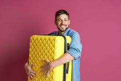Man with overweight luggage. Man with overweight luggage on colorful background royalty free stock photos