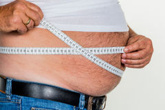 Man with overweight. Photo icon for beer belly, unsuccessful dieting and poor nutrition stock photo