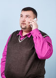 Man with overweight speaks on the phone Royalty Free Stock Images