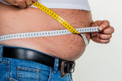 Man with overweight. Symbolic photo for beer belly, unsuccessful diets and poor diet stock photos