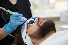 Man during oxygen therapy. Man at beautician`s during oxybrasion treatment Stock Photography