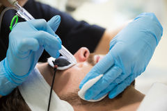Man during oxygen therapy. Man at beautician`s during oxybrasion treatment Royalty Free Stock Photography