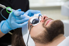 Man during oxygen therapy. Man at beautician`s during oxybrasion treatment Royalty Free Stock Photos