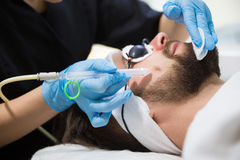 Man during oxygen therapy. Man at beautician`s during oxybrasion treatment Stock Photo