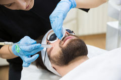 Man during oxygen therapy. Man at beautician`s during oxybrasion treatment stock images