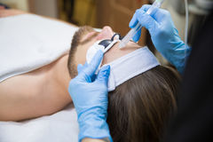 Man during oxygen therapy. Man at beautician`s during oxybrasion treatment royalty free stock image
