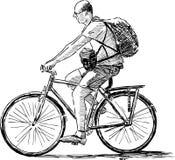 Man på en bycicle Arkivbild