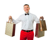 Man på hållande shoppingpåsar för försäljning Arkivbilder