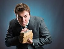 Man with pack of money  isolated on blue Stock Image