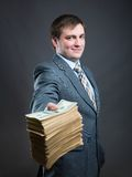 Man with pack of money  isolated on gray Stock Photo
