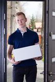 Man with a package Royalty Free Stock Image
