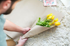 Man packing bouquet Stock Images