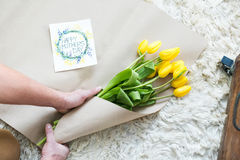 Man packing bouquet Stock Photo