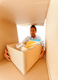 Man packing in boxes Royalty Free Stock Photography