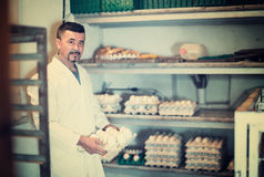 Man packing hen eggs in farmhouse Royalty Free Stock Photo