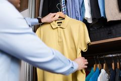Man packing his clothes and stuff stock images