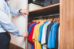 Man packing his clothes and stuff stock image