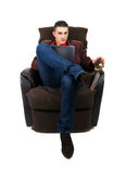 Man with pad and whiskey. Business man with pad and whiskey sitting on the couch. White background Royalty Free Stock Photo