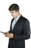 Man with pad on white Stock Image