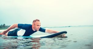 Man padding to line up on the surf board Royalty Free Stock Image