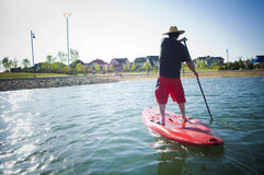 Man on a paddle board on lake royalty free stock images