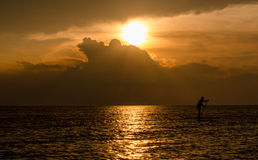 Man on paddle board and  Michigan sunset Stock Images