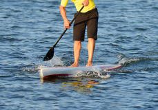 Man on a paddle board in ocean Stock Image