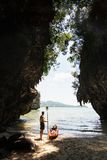 Man with a paddle standing next to sea kayak at secluded beach in Krabi, Thailand. Man with a paddle standing next to sea kayak at secluded beach in Krabi stock photo