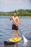 Man on paddleboard. Stock Image