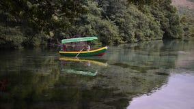 Man paddles a boat on lakes