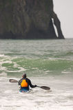 Man Paddles into Ocean Surf Riding Sea Kayak Boat Sport Royalty Free Stock Images