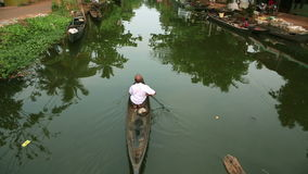 Man paddling on canal Stock Photo
