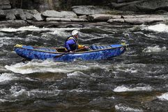 Man Paddling A Canoe In The Hudson White Water Derby In North Cr. Canoeist On The Hudson River, Hudson RiverWhite Water Derby, Adirondack Forest Preserve, New royalty free stock photo
