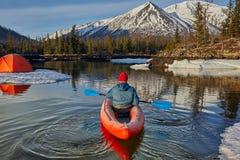 Man paddling kayak in mountain lake. Freedom. royalty free stock photo