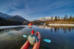 Man paddling kayak in mountain lake. Freedom. stock photography