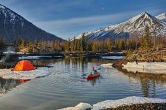 Man paddling kayak in mountain lake. Freedom. stock photo