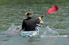 Man Paddling a Kayak royalty free stock photos