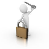 Man with a padlock and a key Royalty Free Stock Image