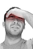Man in Pain. A young man grasping his head where the pain is - a killer headache or migraine Stock Photo