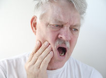 Man with pain in cheek Royalty Free Stock Images