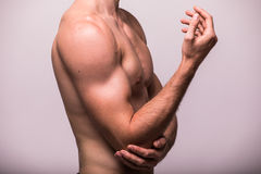 Man With Pain In Elbow. Hand pain  on grey background. Man With Pain In Elbow. Hand pain Stock Photography